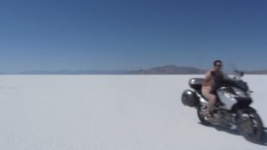 ride motorcycle naked across the salt flats